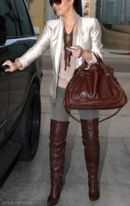 Kim looking good with boots and bag.