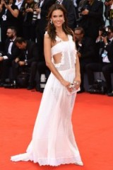 Wearing a sheer white cut away gown, Alessandra Ambrosio looked stunning on the red carpet at the Venice Film Festival 2015. Celebrity style – gowns