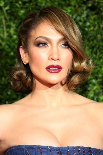 Jennifer Lopez with a glamorous curled bob, tucked behind one ear. Celebrity hairstyles | dramatic eye make up | dark red lips - flipped