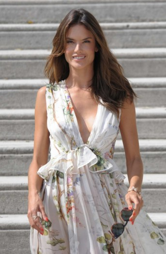 Alessandra Ambrosio heads to the Venice Lido beach for a photocall, wearing a plunging, floral chiffon maxi dress from Philosophy Di Lorenzo Serafini, Venice Film Festival, 3 September 2015. Celebrity fashion | deep V-necklines | designer gowns | star style