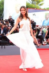 Model Alessandra Ambrosio shines on the red carpet in a sheer white cut out gown with frilled edges, while attending the Everest premiere at the 72nd Venice Film Festival, 2 September 2015. Celebrity fashion | star style | gowns | events
