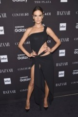 Model Alessandra Ambrosio in a black cut out dress attends the 2015 Harper's BAZAAR ICONS Event in NYC, 16 September. Celebrity style | one shoulder gowns / glamorous celebrities / glamour