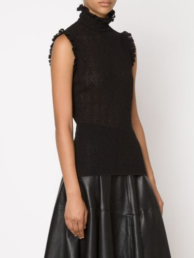 ALEXANDER MCQUEEN Victorian lace knit top in black. Luxe fashion | designer knitted tops | high ruffled neck | ruffle trim  #