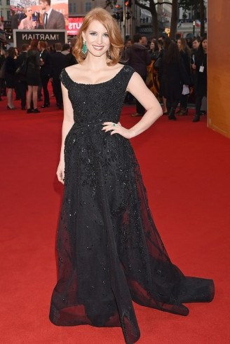 Jessica Chastain in a black embellished Elie Saab gown, attending the London premiere of The Martian, 24 September 2015. Celebrity fashion | star style | film premieres | red carpet events | designer gowns - flipped