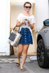 Lily Collins wearing an Alexa Chung for AG A-line denim skirt and oversized tee. Celebrity street style | casual fashion
