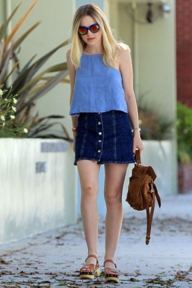 Dakota Fanning street style in a blue chambray top and Alexa Chung for AG Jeans A-line denim skirt. Celebrity fashion | casual style - flipped