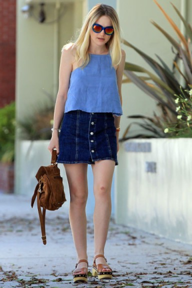 Dakota Fanning street style in a blue chambray top and Alexa Chung for AG Jeans A-line denim skirt. Celebrity fashion | casual style