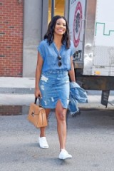 Gabrielle Union does triple denim…distressed denim skirt, chambray shirt and carrying a denim jacket. Casual celebrity fashion | street style outfits