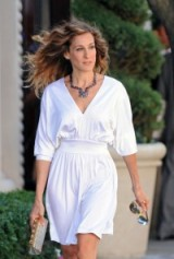 Carrie Bradshaw in a white Halston dress, Solange Azagury-Partridge mixed gem necklace & carrying a gold & silver Chanel clutch ~ SATC2 #SJP