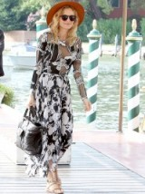 Diane Kruger arrived at the 2015 Venice Film Festival looking gorgeous in a black and white floral ensemble from the Thakoon Resort 2016 Collection. This chic outfit consisted of a part-sheer bodysuit and pleated skirt with uneven hem, Komono Clement sunglasses in Cocoa, large black Chanel quilted tote, brown wide brim hat from janessaleone.com and tan flat sandals…fabulous! Venice, Italy. 1 September 2015. Celebrity fashion | star style | stylish outfits | events