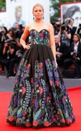 Elizabeth Banks wearing a strapless Andrew Gn floral embroidered gown, with a fitted sweetheart bodice and full pleated skirt – 2015 Venice Film Festival. Celebrity style | designer statement gowns