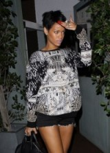 Rihanna in 2012 wearing a Mary Katrantzou Precious Metal Pattern oversized sweater. Celebrity style / designer fashion / printed tops