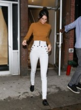 Kendall Jenner street style…white Isabel Marant high waisted skinny trousers & dark mustard polo neck jumper. Celebrity fashion | celebrities | outfit inspiration