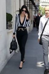 Kendal Jenner street style in Paris, June 2015…Givenchy cropped, plunging stripe jumper, black skinny jeans and B-Low The Belt Bri Bri belt. Celebrity fashion | outfits | outfit inspiration