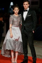 Kristen Stewart in Chanel & Nicholas Hoult looking gorgeous in a black tuxedo and bow tie, pose on the red carpet at the premiere of Equals, Venice Film Festival, September 2015. Celebrity fashion | star style | events | actors suits | couture dresses