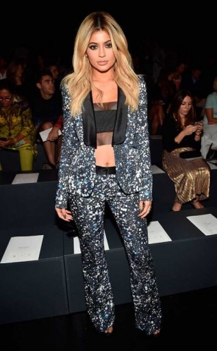 Kylie Jenner in a splatter print pant suit and black crop top, Front Row at the Prabal Gurung Spring/Summer 2016 fashion show NYFW. Celebrity outfits | star style | celebrities at fashion shows