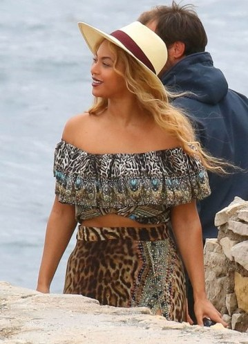 Beyonce in an animal print, off the shoulder crop top & leopard print skirt, on Sainte-Marguerite Island, Cannes, 16 Sept 2015. Celebrity fashion | star style | prints - flipped