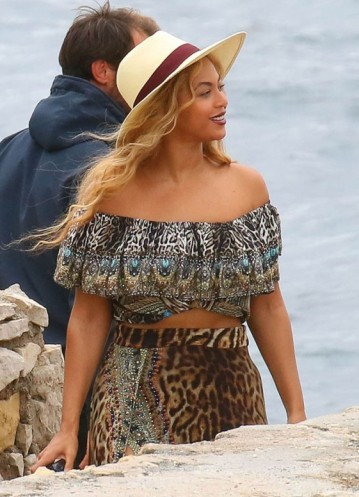 Beyonce in an animal print, off the shoulder crop top & leopard print skirt, on Sainte-Marguerite Island, Cannes, 16 Sept 2015. Celebrity fashion | star style | prints