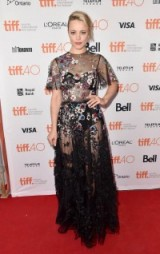 Rachel McAdams on the red carpet, wearing a sheer floral Valentino gown, attending the Spotlight premiere 2015 TIFF. Celebrity fashion | star style | designer gowns | Toronto Film Festival