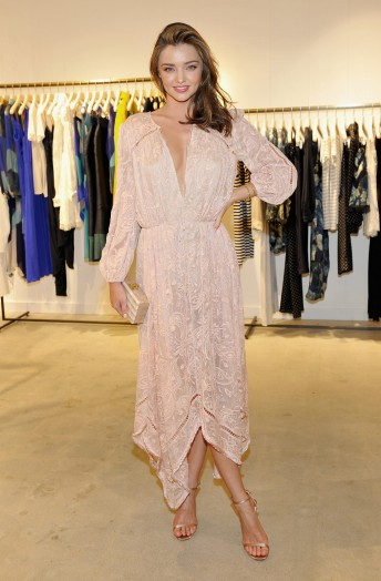 Model Miranda Kerr in July 2015, wearing a blush handkerchief dress by Zimmermann, at the launch of the brands flagship store on Melrose Place, West Hollywood. Celebrity fashion | designer dresses | star style | models