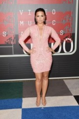 Demi Lovato in a pink Nicolas Jebran Long Sleeved, Mosaic Cut-out Bodycon Dress & nude pointy pumps, at the 2015 MTV Video Music Awards in LA. Celebrity fashion ~ star events ~ designer dresses