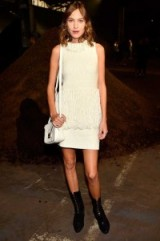 Style icon Alexa Chung attending the 3.1 Phillip Lim Spring/Summer show at NYFW…white sleeveless knitted shift dress, with fringe detail, suede lace up calf length boots & white shoulder bag. Celebrity fashion | star style | Front Row celebrities | knitwear | dresses