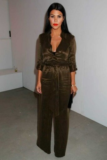Kourtney Kardashian wearing an Alice + Olivia Casy silky jumpsuit from aliceandolivia.com at the Alice + Olivia by Stacey Bendet S/S 2016 presentation, NYFW. Celebrity fashion | designer jumpsuits | star style | what celebrities wear | New York Fashion Week - flipped