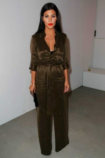Kourtney Kardashian wearing an Alice + Olivia Casy silky jumpsuit from aliceandolivia.com at the Alice + Olivia by Stacey Bendet S/S 2016 presentation, NYFW. Celebrity fashion | designer jumpsuits | star style | what celebrities wear | New York Fashion Week