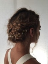 Olivia Palermo's stunning braided updo finished with a jewelled hair accessory. #oliviapalermo #hairstyles #updos