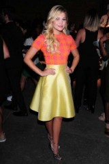 Olivia Holt attends the Christian Siriano Spring/Summer 2016 show at New York Fashion Week. Celebrity style | star outfits | celebrities at fashion shows | skirts and sweaters