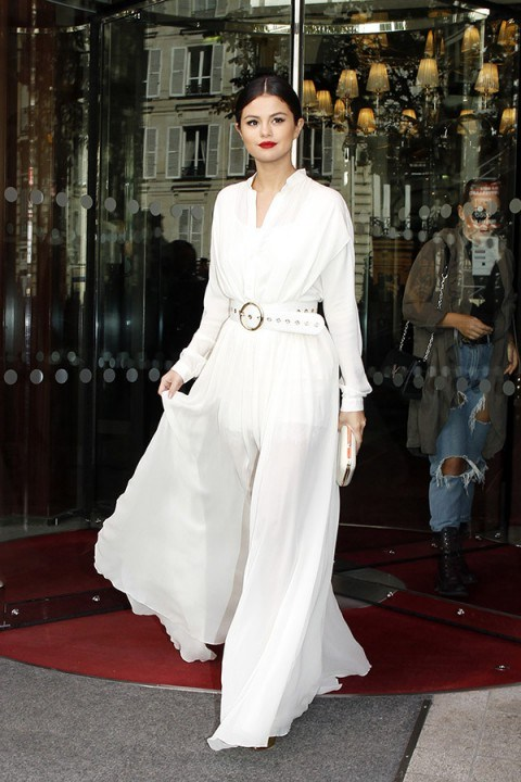 Selena Gomez left her hotel in Paris looking cool & sophisticated, wearing a white belted semi sheer maxi dress, with long sleeves & flowing skirt, 26 September 2015. Celebrity chic style / long dresses - flipped