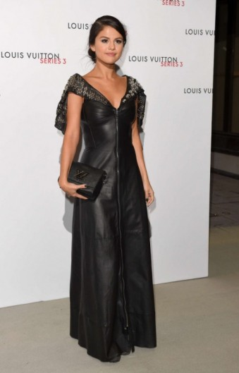 Selena Gomez wore a black leather Louis Vuitton gown, with cape style sleeves and stud detail, to the Louis Vuitton Series 3 VIP Launch in London, 20 September 2015. Star style / celebrity fashion / events / designer dresses  #