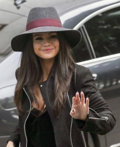 Selena Gomez arriving at the ITV studios, wearing a grey & burgundy Maison Michel large fedora hat and a black leather biker jacket, September 2015. Celebrity style / celebrities wearing hats  #