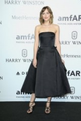 Dakota Johnson wore a black strapless fit & flare Christian Dior midi dress, at the amfAR Milano Gala on 26 Sept 2015, Milan, Italy. Celebrity style / designer dresses / occasion gowns / MFW events  #