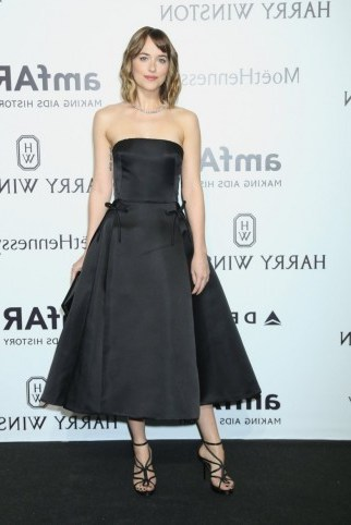 Dakota Johnson wore a black strapless fit & flare Christian Dior midi dress, at the amfAR Milano Gala on 26 Sept 2015, Milan, Italy. Celebrity style / designer dresses / occasion gowns / MFW events  # - flipped