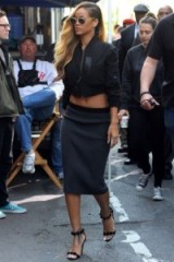 Rihanna in a black cropped bomber jacket, pencil skirt & barely there high heels…great combo! Casual jackets | celebrity fashion | star style