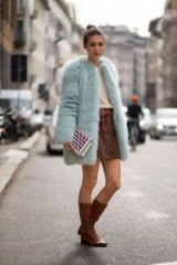 Love this winter street style look with the 70s style, suede A-line skirt, tan boots and duck egg blue fluffy coat…just perfect! Casual chic / outfit inspiration