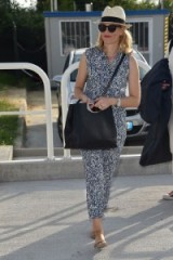 Elizabeth Banks arrives at the Vennice Film Festival looking cool and relaxed wearing a blue and white Splendid Feather Print Jumpsuit, Komono sunglasses and a natural straw fedora hat, Vennice, Italy, 1 September 2015. Celebrity fashion | star style | events | sleeveless jumpsuits