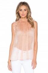 Zimmermann Rhythm Ruffle Top in Leopard. Designer tops | sheer blouses | high neck fashion | ruffles