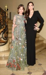 Alexa Chung and Liv Tyler attend the BVLGARI & ROME Eternal Inspiration opening night in New York, October 2015. Celebrity style | Valentino floral gowns | celebrities at events