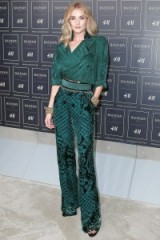 Model Rosie Huntington-Whiteley Front Row at the Balmain x H&M fashion show in New York City on 20 October 2015. Models style ~ outfits ~ celebrities at runway shows ~ green printed trousers ~ green wrap style blouse