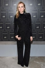 Diane Kruger Front Row at the Balmain x H&M fashion show in New York City on 20 October 2015. Style icon ~ style icons outfits ~ celebrities at fashion shows ~ black velvet jumpsuits