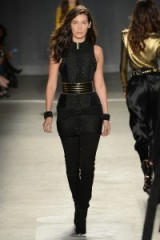 Bella Hadid walks the runway for the Balmain x H&M fashion show in New York City on 20 October 2015. Catwalk fashion ~ models at work ~ all black outfits ~ designer clothing