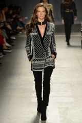 Model Alessandra Ambrosio walks the runway for the Balmain x H&M fashion show in New York City on 20 October 2015. Models at work ~ designer clothing ~ catwalk fashion ~ black & white embellished tunics ~ outfits