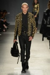 Model Dudley O'Shaughnessy walks the runway for the Balmain x H&M fashion show in New York City on 20 October 2015. Catwalk fashion ~ male models at work ~ mens designer clothing ~ men's embellished jackets
