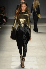 Model Joan Smalls walks the runway at the Balmain x H&M fashion show in New York City on 20 October 2015. Model at work ~ catwalk fashion ~ designer clothing ~ black & gold outfits ~ luxe style ~ models at work