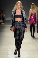 Model Karli Kloss walks the runway for the Balmain x H&M fashion show in New York City on 20 October 2015. Models at work ~ catwalk fashion ~ designer clothing ~ luxe style outfits ~ embellished jackets ~ satin trousers