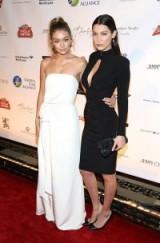 Models Gigi & Bella Hadid attend the Global Lyme Alliance Gala in New York City, 8 October 2015. Celebrity style | red carpet fashion | events | LBD | white strapless gowns
