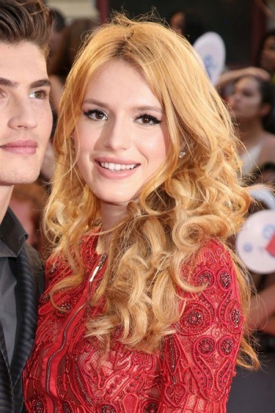 Bella Thorne with long curly strawberry blonde hair, June 2015. Celebrity hairstyles | star style beauty and make up - flipped