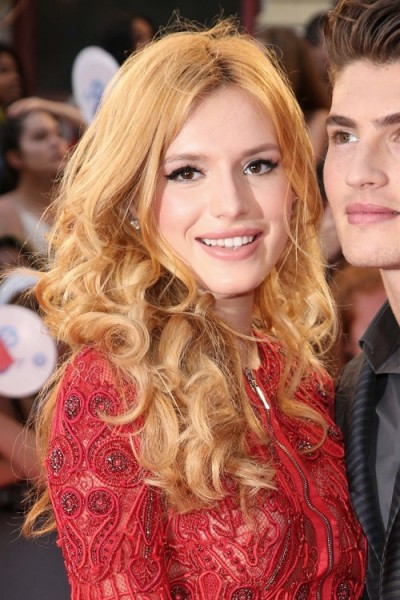 Bella Thorne with long curly strawberry blonde hair, June 2015. Celebrity hairstyles | star style beauty and make up
